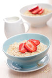 Cereal with fresh strawberry Stock Images