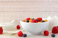 Cereal with fruit against a white wood background Stock Photos