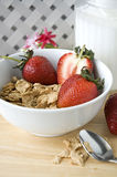 Cereal and fruit for breakfast. Cereal with strawberry for breakfast put on table Stock Photo