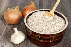 Cereal with garlic and onion. On the wooden table Stock Photography