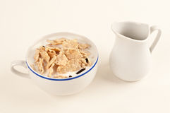 Cereal grains and milk for breakfast stock image