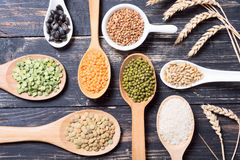 Cereal grains on wooden background Royalty Free Stock Photography