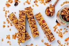 Cereal granola bar with nuts, fruits and berries on a whhite stone table. Granola bar. Healthy snack. Top view stock photo