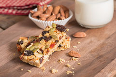 Cereal granola bars with nuts, dried fruit and milk. Royalty Free Stock Photo