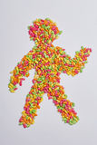 Cereal human. Colored cereals forming a human shape Royalty Free Stock Photo