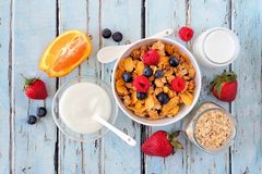 Healthy breakfast cereal and ingredients over blue wood Royalty Free Stock Photo