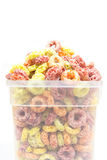 Cereal loops in plastic box. Colorful Cereal loops in plastic box Stock Images