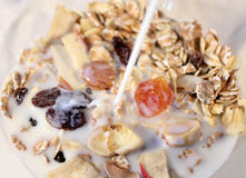 Cereal with milk being poured Royalty Free Stock Photo