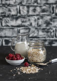 Cereal, milk, raspberries - raw ingredients for cooking a healthy breakfast. Royalty Free Stock Image