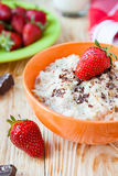 Cereal with milk and ripe strawberries Royalty Free Stock Image