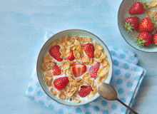 Cereal with milk and strawberries. Healthy breakfast, cereal with milk,  fresh Strawberry,  on a light blue background, horizontal view from above Stock Images