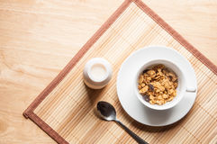 Cereal and milk on wooden table stock photography