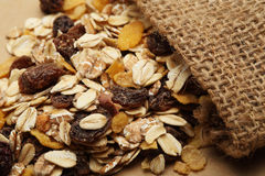 The cereal mix with prunes and raisins in sack. For breakfast royalty free stock photos