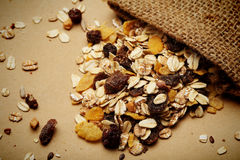The cereal mix with prunes and raisins in sack Stock Photography