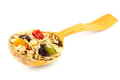 Cereal muesli or oat flakes with dried fruit on wooden spoon studio isolated Royalty Free Stock Photography