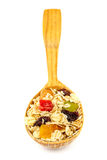 Cereal muesli or oat flakes with dried fruit on wooden spoon studio isolated Stock Image