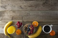 Cereal, muesli and various delicious fruit, berries for breakfast. healthy, energy breakfast, wooden table. Cereal, muesli and various delicious fruit, berries royalty free stock photo