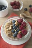 Cereal, muesli and various delicious fruit, berries for breakfast. healthy, energy breakfast, wooden table. Cereal, muesli and various delicious fruit, berries royalty free stock images