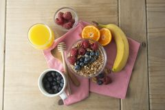Cereal, muesli and various delicious fruit, berries for breakfast. healthy, energy breakfast, wooden table. Cereal, muesli and various delicious fruit, berries stock images