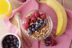 Cereal, muesli and various delicious fruit, berries for breakfast. healthy, energy breakfast, wooden table. Cereal, muesli and various delicious fruit, berries stock photo