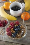 Cereal, muesli and various delicious fruit, berries for breakfast. healthy, energy breakfast, wooden table. Cereal, muesli and various delicious fruit, berries royalty free stock photos