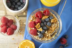 Cereal, muesli and various delicious fruit, berries for breakfast. healthy, energy breakfast, wooden table. Cereal, muesli and various delicious fruit, berries stock photography