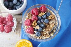 Cereal, muesli and various delicious fruit, berries for breakfast. healthy, energy breakfast, wooden table. Cereal, muesli and various delicious fruit, berries royalty free stock photography