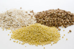 Cereal of oat, buckwheat and millet. Three piles of cereal of oat, buckwheat and millet Stock Photo