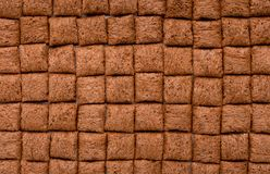Cereal pillows like bar of chocolate. Breakfast cereal pillows in raws like bar of chocolate, top view Royalty Free Stock Photography