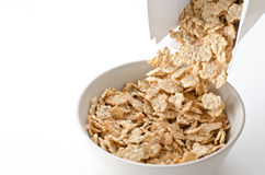 Cereal pouring into a bowl Royalty Free Stock Images