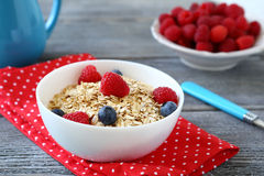 Cereal with raspberries and blueberries Royalty Free Stock Image