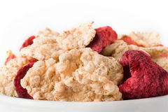 Cereal with red fruits. Wheat and rice flakes with dried red fruits Stock Image