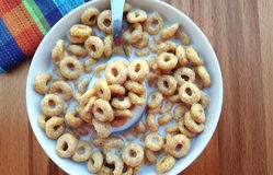 Cereal rings in bowl Stock Photography