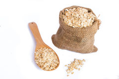 Cereal in sack with wooden spoon Stock Photos