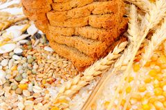 Cereal seeds and bread Royalty Free Stock Images