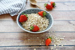 Cereal and strawberries Stock Photos