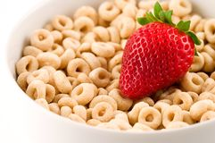 Cereal With Strawberry. Close-up of a bowl with cereal (whole grain oats) and fresh strawberry. Selective focus Stock Image