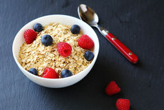 Cereal with sweet raspberries and blueberries Stock Image