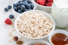 cereal and various delicious ingredients for breakfast, close-up Royalty Free Stock Images