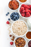 Cereal and various delicious ingredients for breakfast, top view Stock Photos