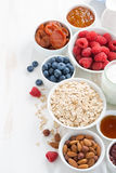 Cereal and various delicious ingredients for breakfast, vertical Stock Photo