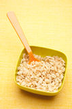 Cereal in a Vibrant Bowl. On a Yellow Background royalty free stock photos