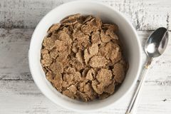 Cereal wheat flakes, spikes and rye grain on old rustic wooden table. Top view. stock photography