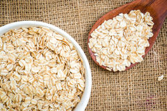 Cereal in white bowl with spoon Royalty Free Stock Images