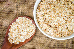 Cereal in white bowl with spoon Stock Image