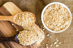 Cereal in white bowl with spoon. Put on sack Stock Photo