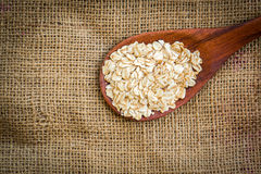 Cereal in white bowl. With spoon put on sack Stock Image