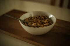 Cereal on White Ceramic Bowl With Spoon Royalty Free Stock Photography