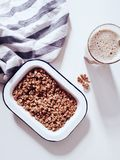 Cereal on White Container With Cup of Coffee Stock Photos