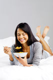 Cereal woman in bed Stock Image